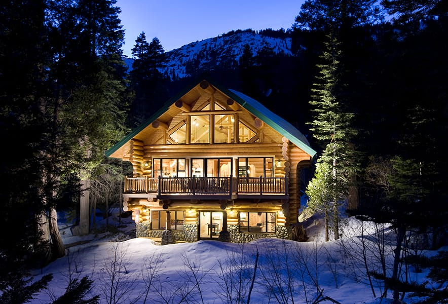 Log home from rear at night