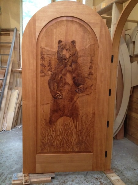 Hand carved wooden doors summit log timber homes