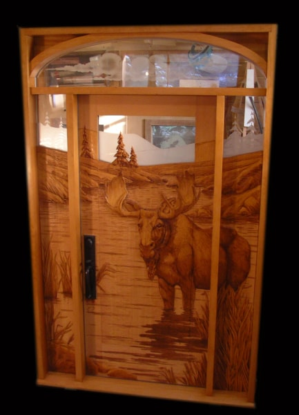 Hand Carved Wooden Doors - $18,000